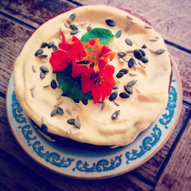 Vegan carrot cake, with sunflower seeds, walnuts, ginger, pumpkin seeds topped with vanilla vegan buttercream and nistercium